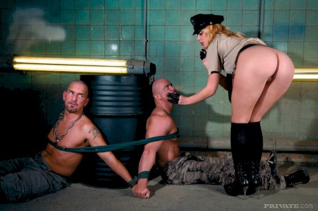 Blonde copper frees her captives prior to a hardcore double penetration