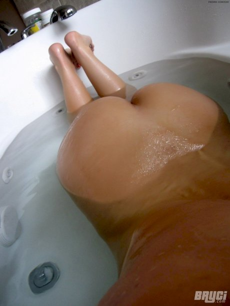 Dark haired amateur shows off her hairy cunt while taking a bath