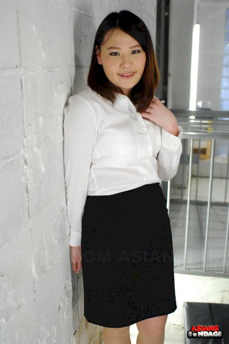 Asian chick Aki Sasahara is fitted with gag in white blouse and black skirt
