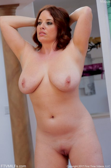 Chubby mom Maggie oils her belly, big boobs, and perfectly shaved pussy