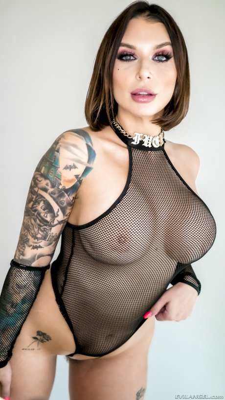 Tattooed beauty Ivy Lebelle slides her onesie aside after exposing her boobs