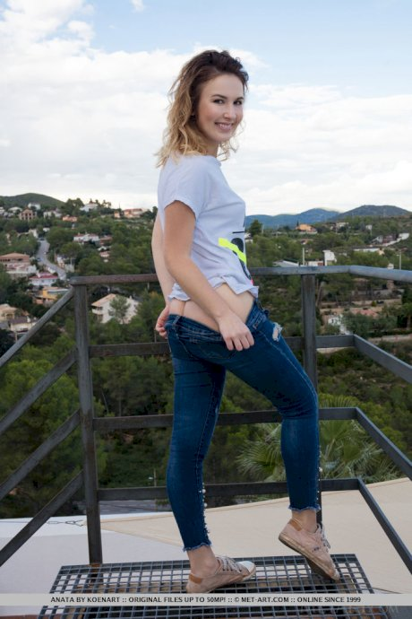Charming teen Anata strips naked at a popular lookout point in solo action