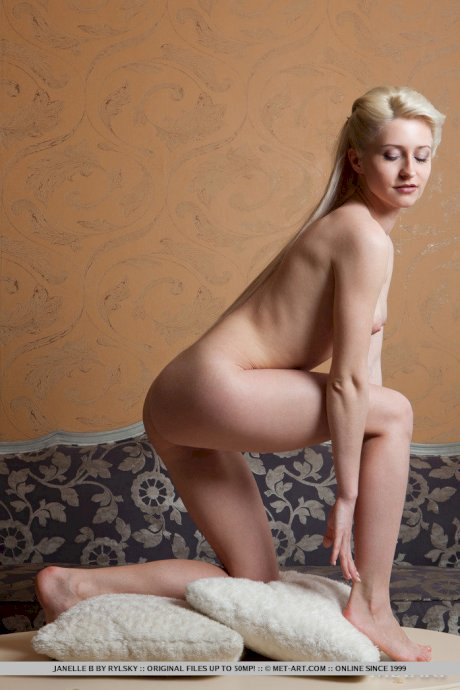 Slim blonde starlet with long legs Janelle B poses sensually