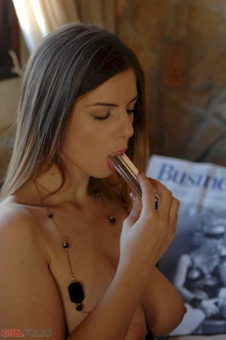 Big titted chick Stella Cox sucks on a sex toy after removing her glasses