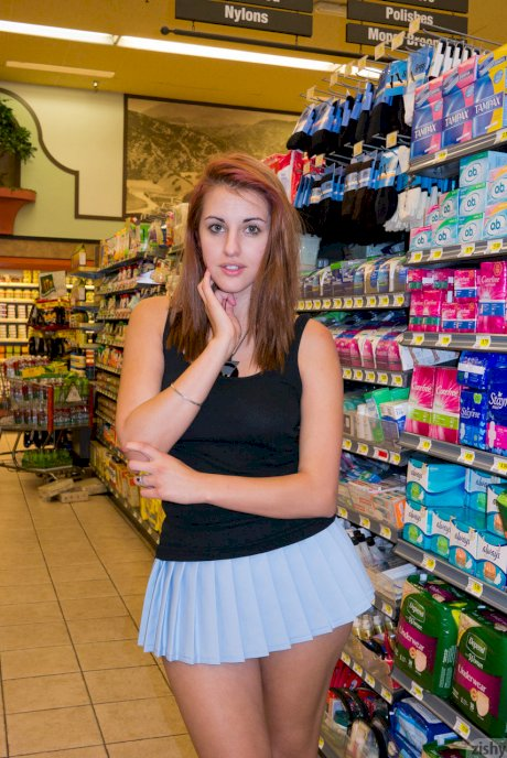 Shameless teen Tabitha Bishara flashes her pink panties at the store