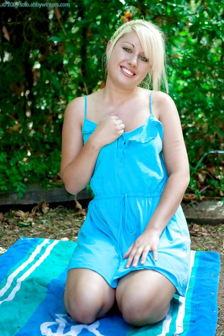 Fresh faced blonde Aisling strips naked outdoors and spreads hairy vagina