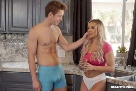 Delicious blonde Kylie Page gives a horny guy a titjob & BJ in the kitchen