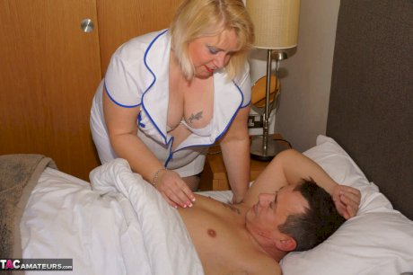 Obese blonde nurse Lexie Cummings sits on a patient's face after fucking him