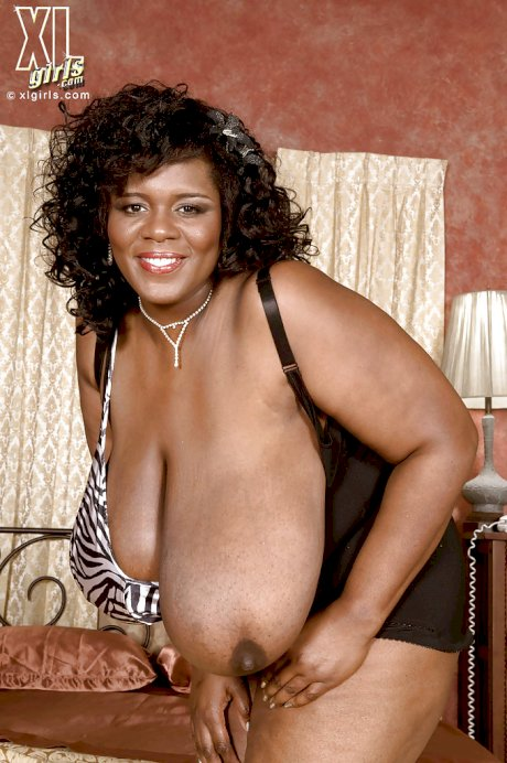 Busty black bbw Shar Nitzapanus almost loses her dildo between ginormous tits