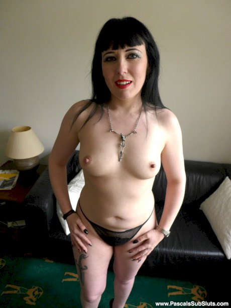 Dark haired goth lady Sexy Cleo kneels in the nude like a good sex slave would