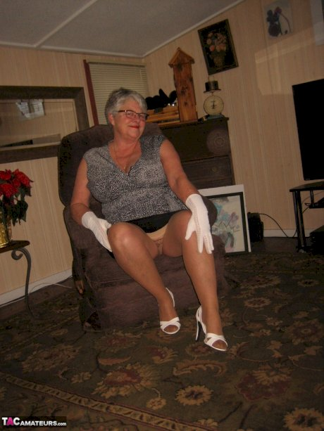 Old oma Girdle Goddess flaunts her saggy breasts wearing tan pantyhose