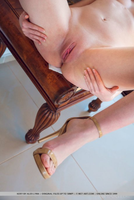 Natural blonde removes cute panties on way to showcasing her shaved vagina