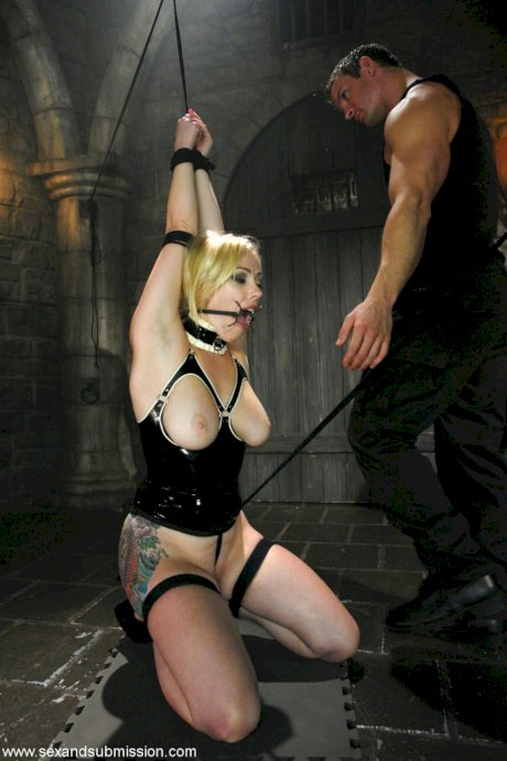 Busty blonde MILF Adrianna Nicole punished and facefucked in the dungeon