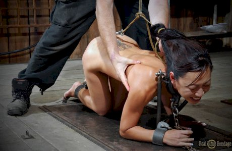 Asian chick Tia Ling endures being humiliated by a woman while in bondage