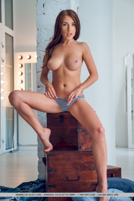 Beautiful young girl Niemira doffs denim clothing to model totally naked