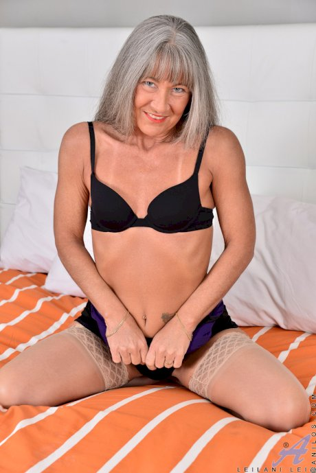 Gray haired mature Leilani Lei shows her tiny tits and plays with sex toys