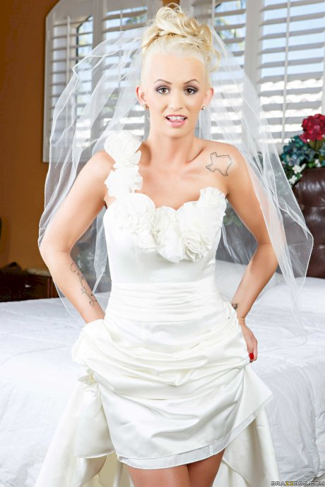 Bride Emily Austin reveals big fake tits & tanned body under her wedding dress