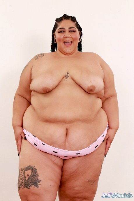 SSBBW Crystal Blue removes a bra and panty set to pose naked in shoes