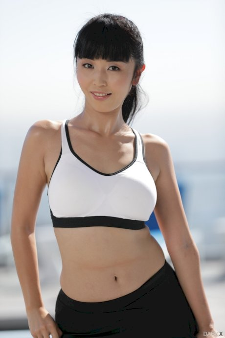 Adorable Asian chick Marica Hase bares her natural tits and bush on a rooftop