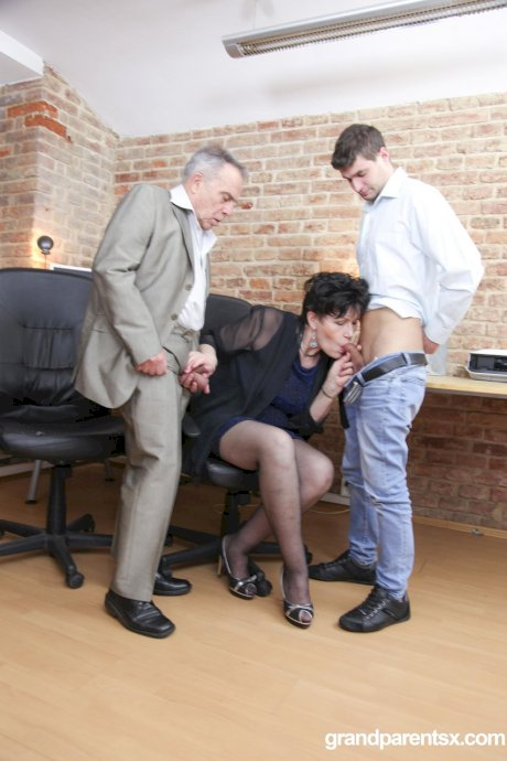Mature woman and a hot young wife share their husbands in the office