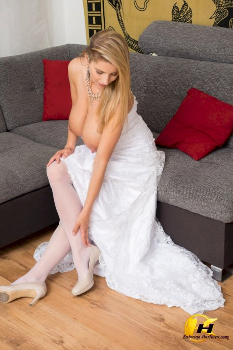 Sexy blond Katerina Hartlova oils her hooters before toying in a wedding dress