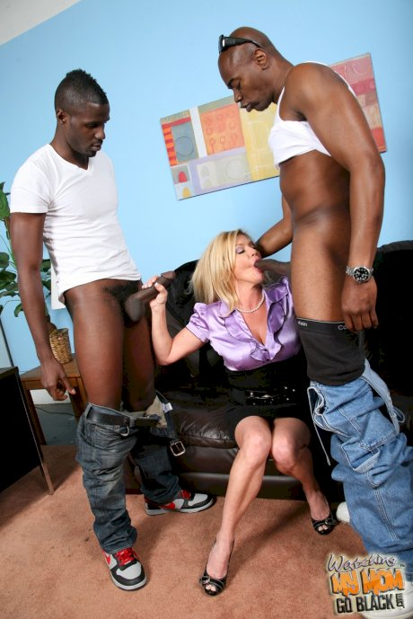 Older blonde lady Ginger Lynn goes 2 on 1 with a couple of black men
