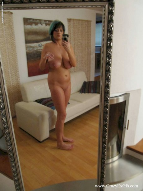 Big titted amateur sports dyed hair while taking naked selfies in a mirror