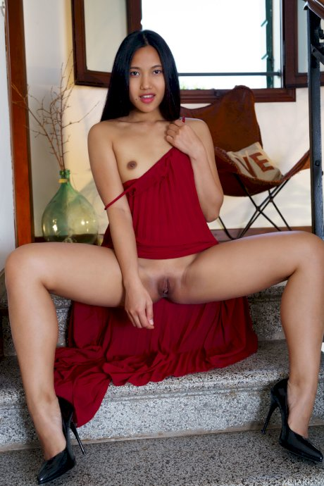 Glamour babe in a long maroon dress May Thai strips to show her delicious slit